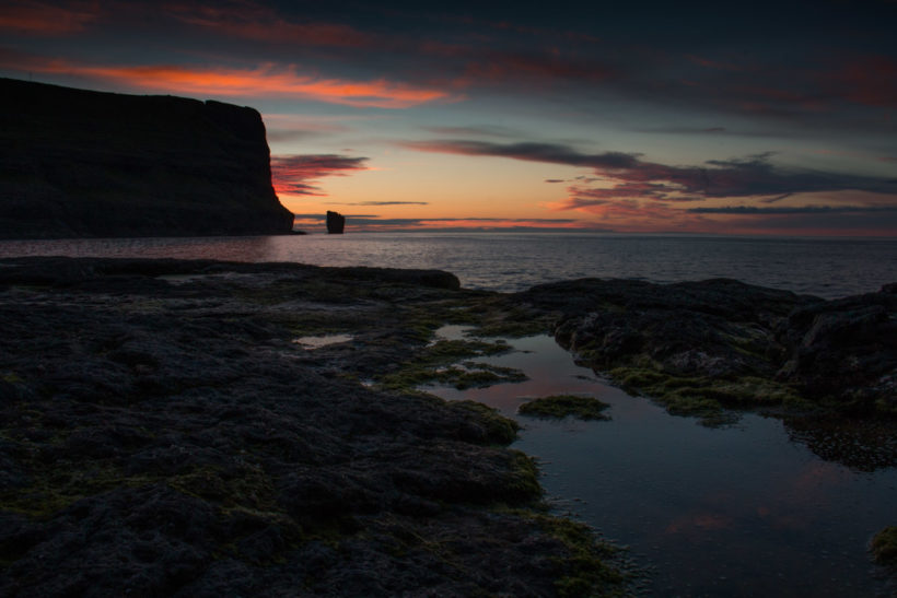 Sunset over the stone trolls Risin og Kellingin, Eiði, Eysturoy Island, Faroe Islands