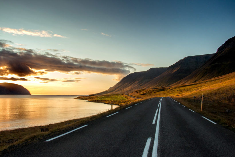 Setting sun on a golden and the open road stretching out before you, Flateyri, Westfjords, Iceland